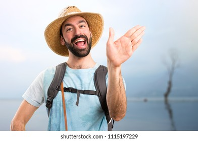 Funny tourist saluting in a beautiful landscape