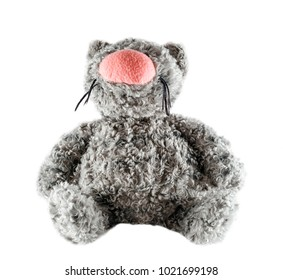 Funny toy gray cat isolated on white background. Fluffy toy plush cat with big pink nose close up