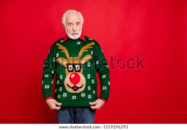 Is it funny ugly pullover for me? Portrait of negative upset old man get winter christmas tradition seasonal sweater for present dislike it isolated over red color background