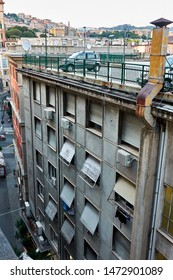 Funny uncommon car park on the roof-top of apartment house in Genoa, Italy