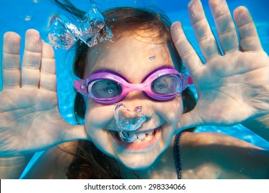 Funny underwater portrait of  cheerful girl