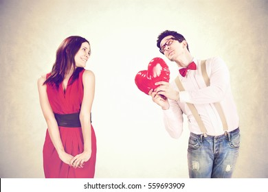 Funny Valentine's Day,romantic boy gives a heart to his girlfriend