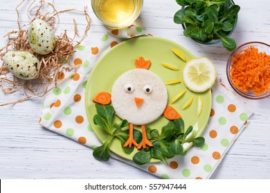 Funny vegetables, sandwich in a shape of chick, food for kids Easter idea, top view