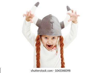 funny viking girl, isolated background, soft helmet with pigtails on head, scares, theatrical classes, emotional,  tricky glance, theater game