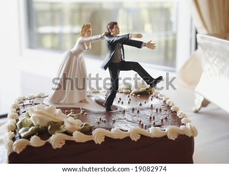 Funny wedding cake top, bride chasing groom