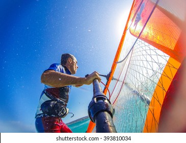 Funny windsurfing on the crystal clear waters and reef