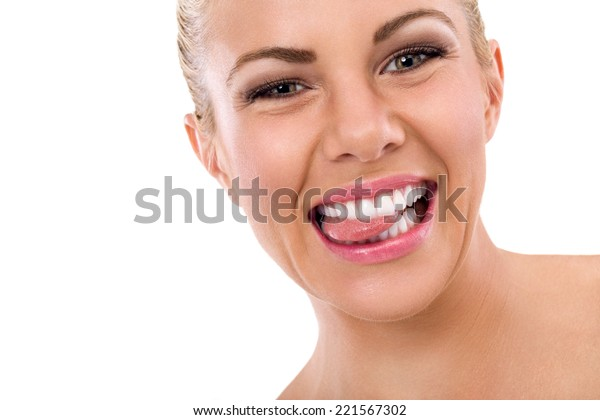Funny woman biting her tongue with healthy teeth