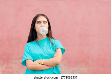 Funny Woman Blowing Bubble with Chewing Gum. Rude defying rebel girl chewing on bubblegum
