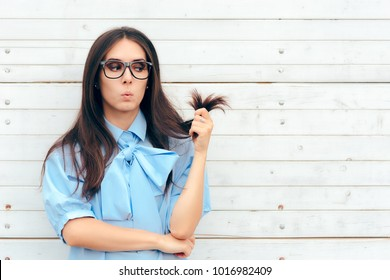 Funny Woman Checking Her Hair for Split Ends Cute brunette girl with long hair in need for a urgent hair cut