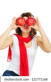 Funny woman holding apples fruit for her eyes. Isolated on white