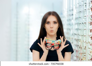 Funny Woman Holding Many Eyeglasses Frames in Optical Store Happy girl wearing lots of colorful spectacles at the same time