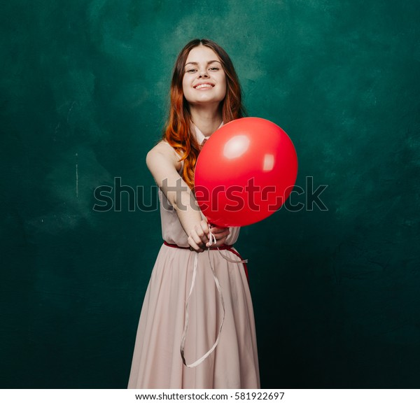 Funny woman holds a camera in a balloon