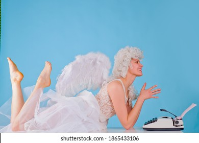 Funny woman typing valentines card. Cupid angel. Valentines angel girl. Valentines Day