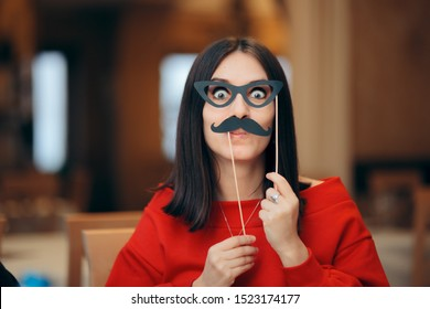 Funny Woman Wearing Party Mask Accessory. Quirky girl acting playful and having fun celebrating