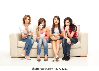 funny women sitting on couch watching sad movie depressed