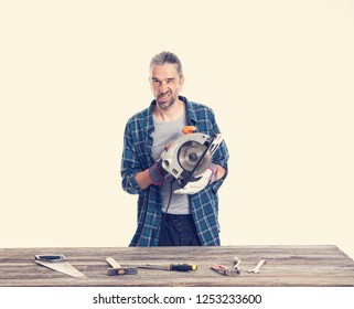 funny worker in blue plaid  shirt working with electric saw
