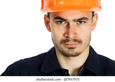 Funny worker in helmet with emotion on her face on white background