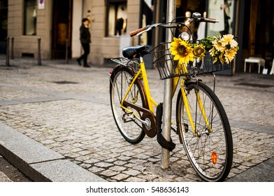 a funny yellow bicycle in the city center of Milan
