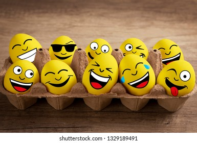 Funny yellow Easter eggs, happy fun Easter background