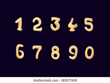Funny yellow numerals from cereals products isolated on a black background