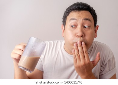 Funny young Asian man want to throw up after drink his disgusting bad iced coffee