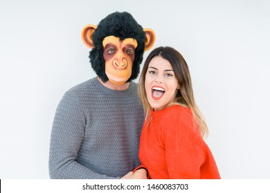 Funny young couple, boyfriend wearing monkey mask, crazy and idiot relationship in love