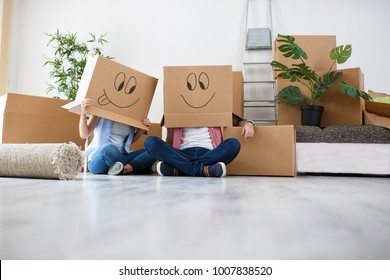 Funny young couple enjoy and celebrating moving to new home, moving concept