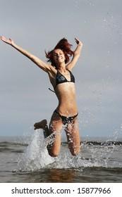 funny young girl having fun on the sea
