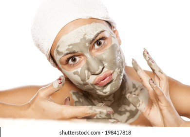 funny young girl with a mask on her face
