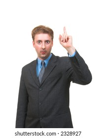 Funny young man in business suite pointing his finger up as if he had an idea isolated on white