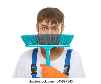 Funny young man with floor brush on white background, close up