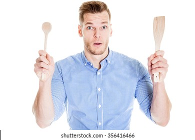 funny young man with kitchen tools
