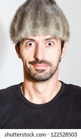 Funny young man in warm hat