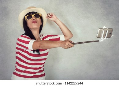 funny Young woman smiling taking a selfie on smartphone
