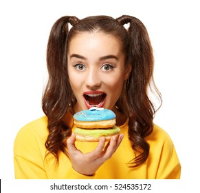 Funny young woman with tasty donuts on white background