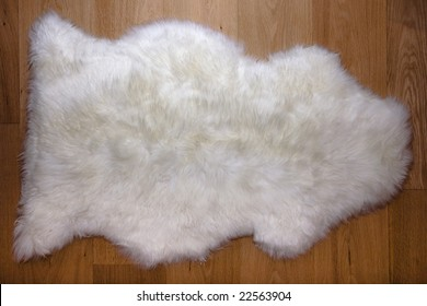 Fur carpet on oak wooden floor