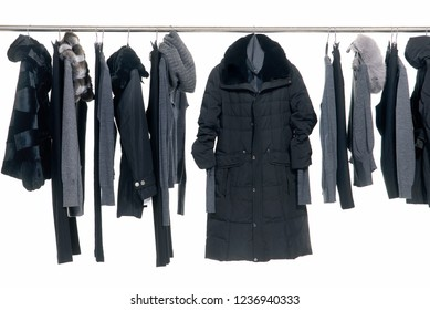 Fur coat,jeans, jacket, ,sweater clothes on Hangers-white background