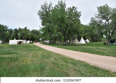 Fur trapper camp reenactment.  White tents and tepees.
