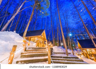 Furano, Hokkaido, Japan winter cabins at twilight.