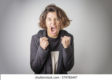 Furious angry woman screaming with rage and frustration