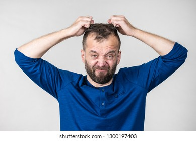 Furious bearded adult man, guy acting crazy being mad having mental crisis