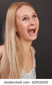 Furious blonde woman with a grimace on a face