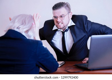 Furious  boss man screaming agressively at female worker. Stress, work, conflict, scandal concepts. Horisontal image.