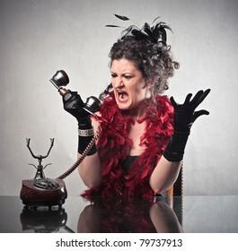 Furious elegant woman quarreling on the telephone