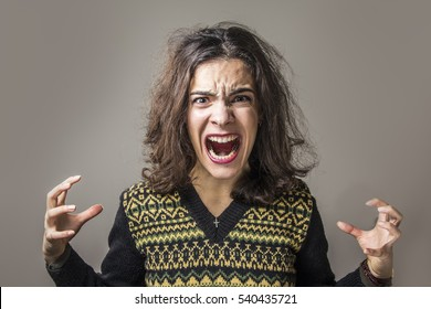Furious and frustrated woman screaming with rage