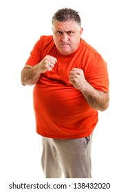 Furious man clenching his fists, ready to fight, against white background