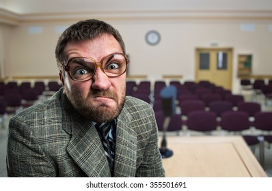 Furious speaker in glasses at hall