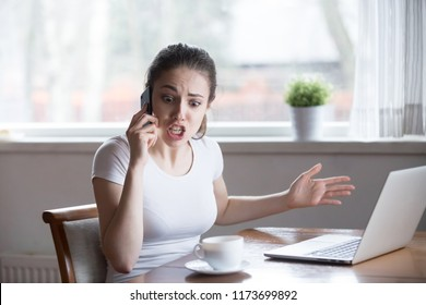 Furious woman argue talking on phone having problems with boyfriend or lover, mad female call customer support have problems with laptop, angry girl scream during emotional conversation over phone