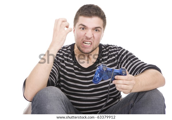 Furious young man with a joystick for game console
