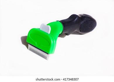 Furminators green lying on the white background